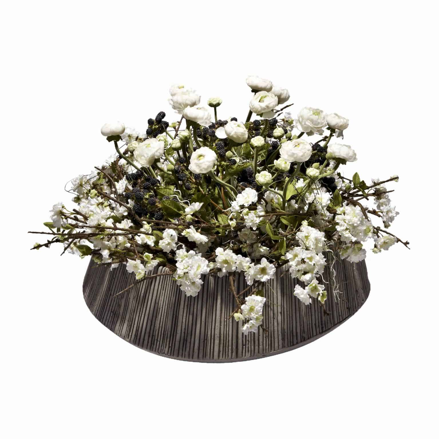 Shop for our countryside arrangement with delicate white silk blossom flowers and flawless ranunculus artificial flowers with blackberries