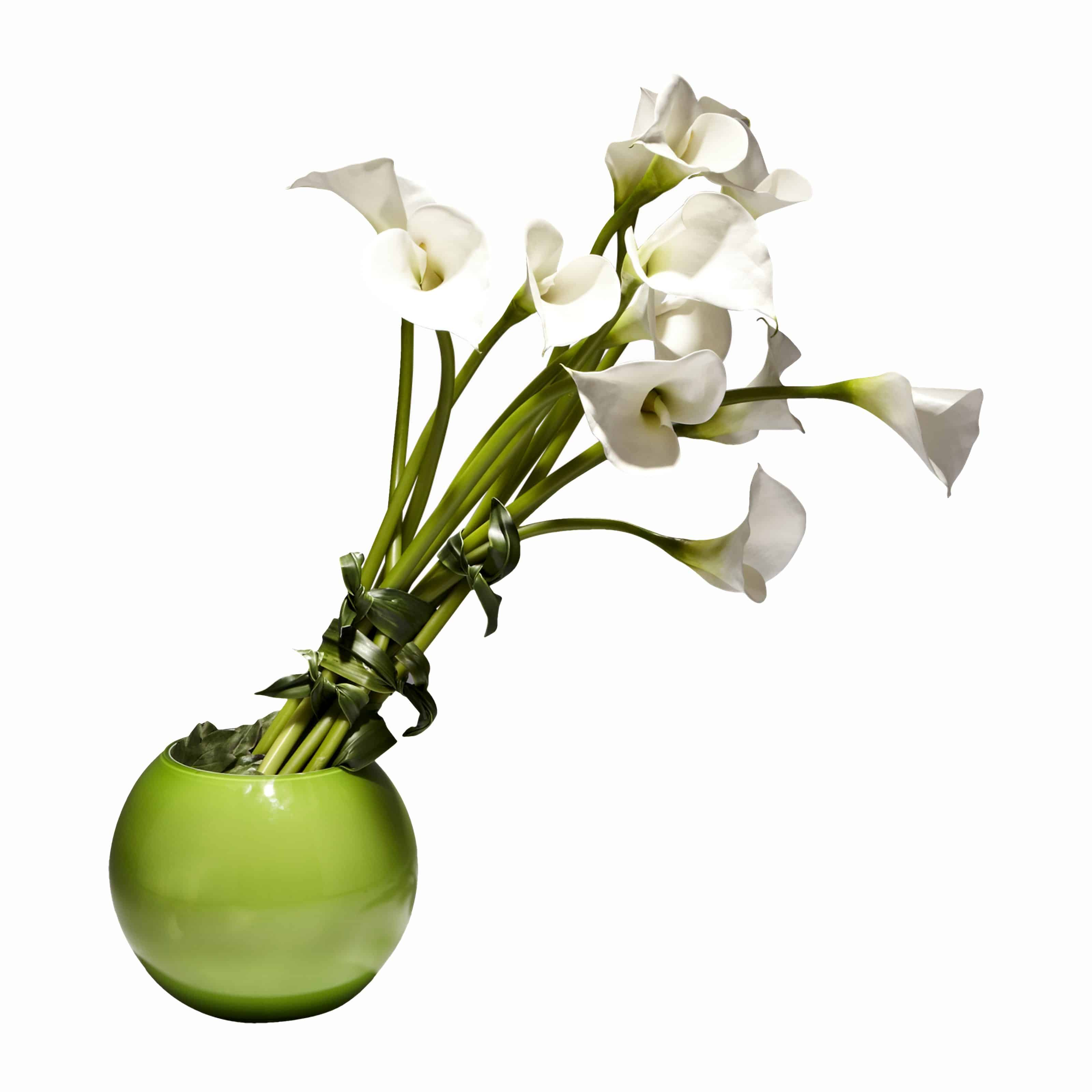 Buy our modern arrangement of fine silk lily flowers in a vibrant green bowl vase. Brighten everyone's day with this stunning faux flower arrangement.