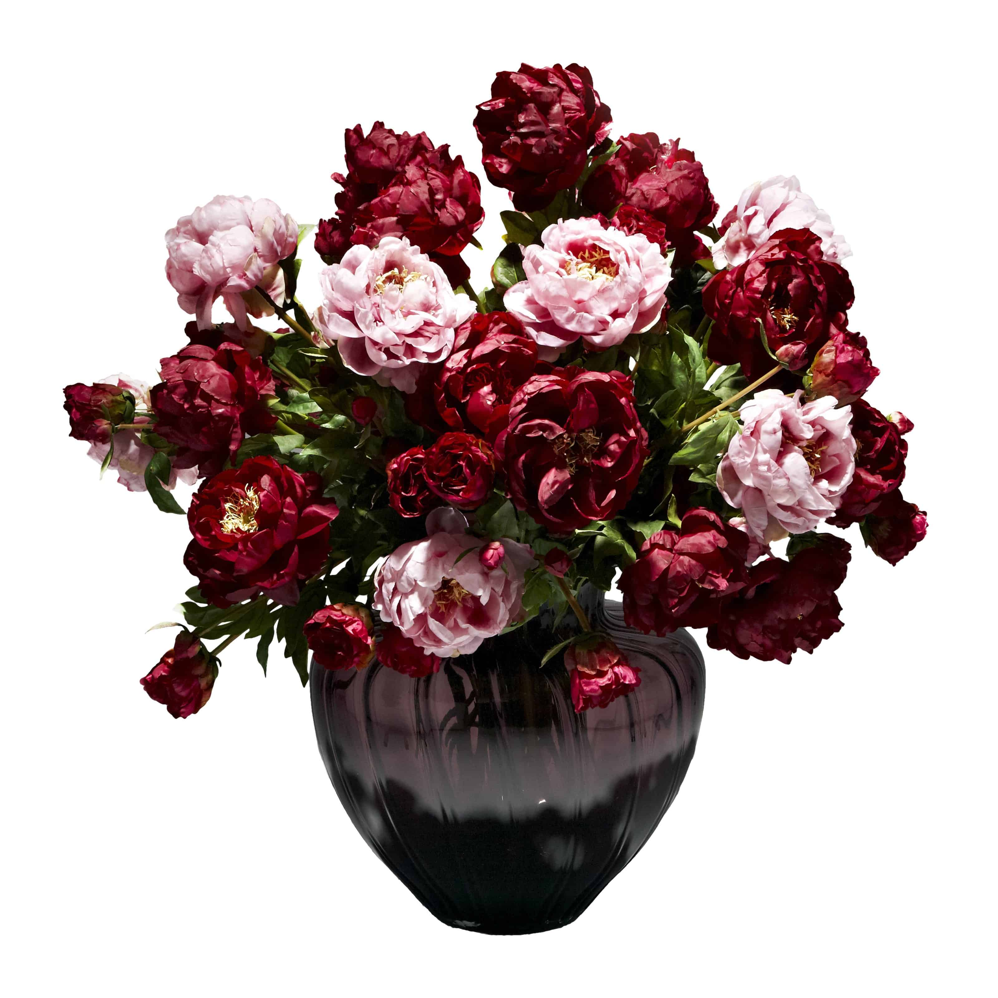 Shop for our lavish display of silk peony flowers in lavender and rich burgundy. Inspired by the paintings of extravagant blooms