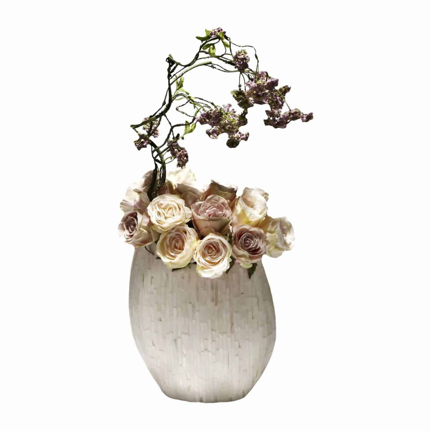 Buy and enjoy garden and woodland in this harmonious arrangement. Peach and Lilac artificial silk flower roses with falling soft purple snowball branches.