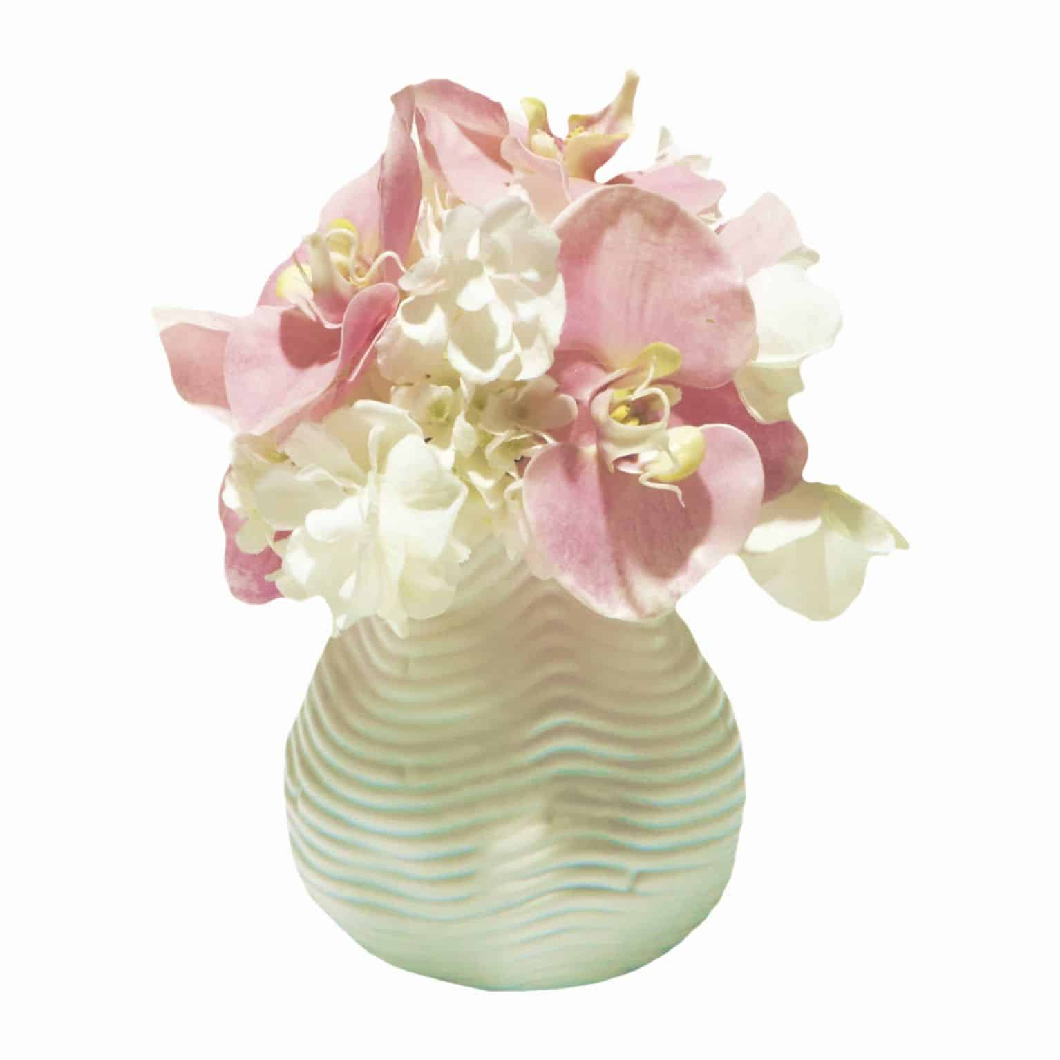 Buy our sweet little vase arrangement of glowing silk white butterfly hydrangea flowers and pretty pink phalaenopsis orchid artificial flowers.