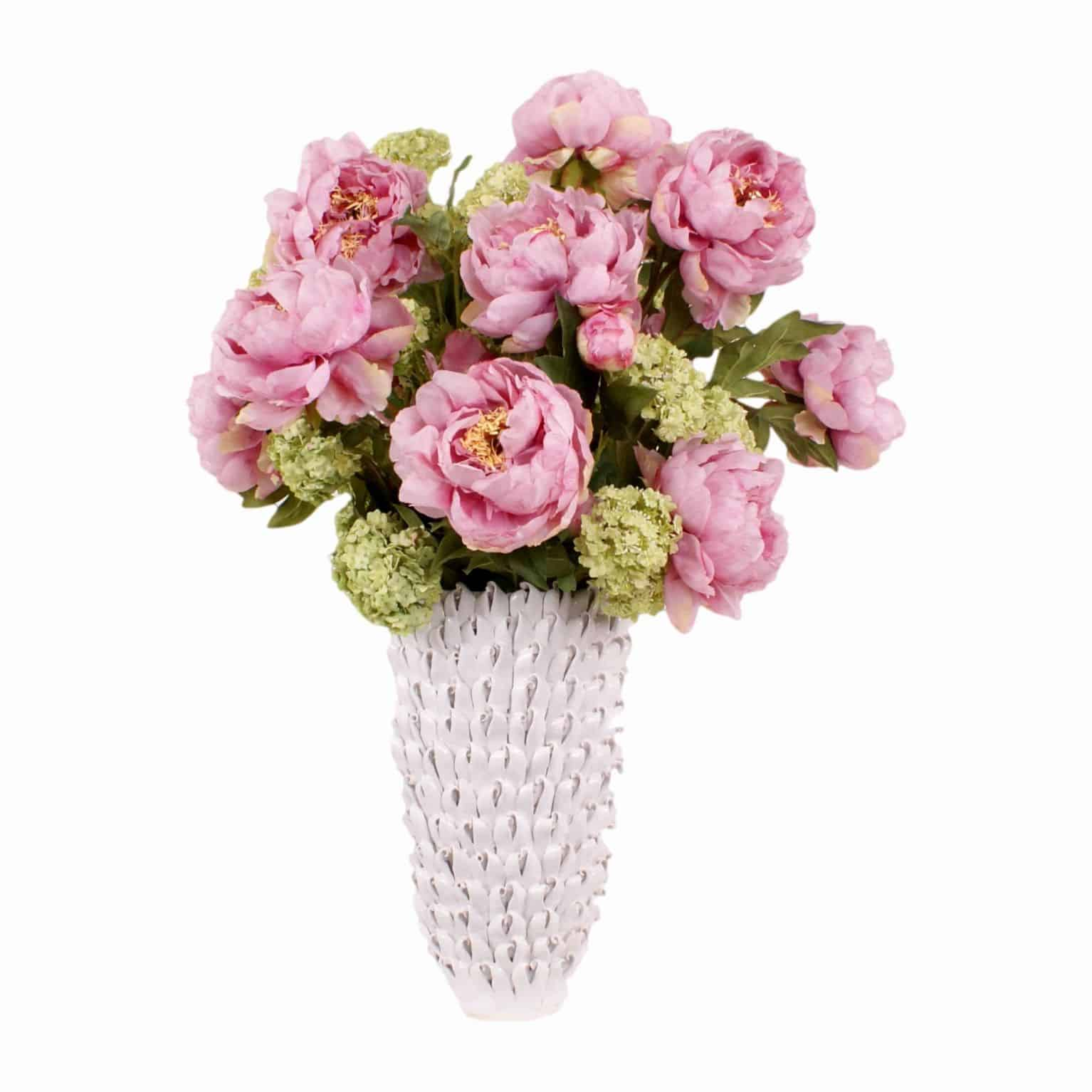 Shop for bloomed silk flower soft pink peonies with ruffled petals & flawless pollen. Mixed with artificial green guelder rose in a ceramic seashell vase.