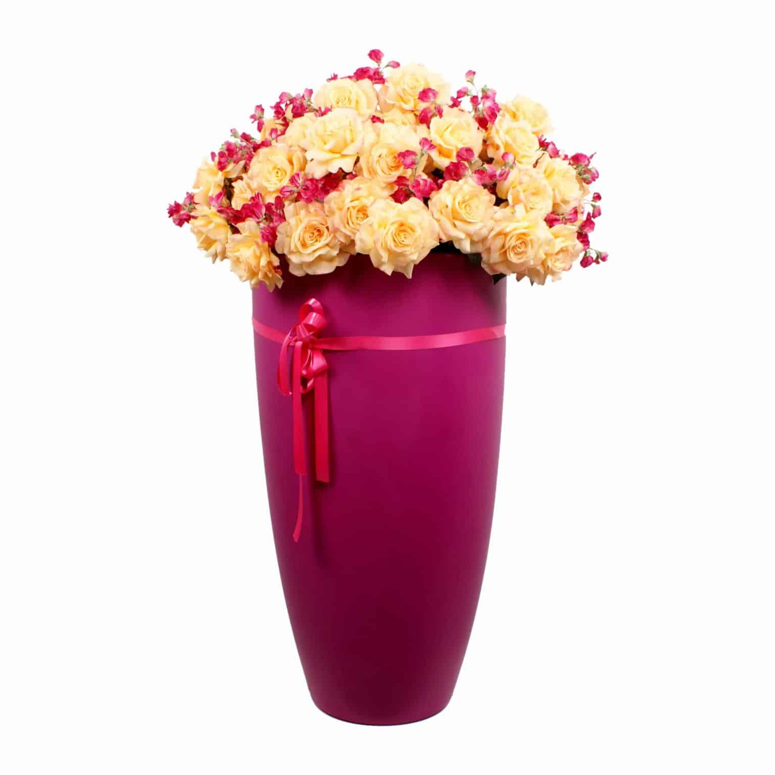 Buy sunshine! Yellow tea rose silk flowers layered with soft petals and artificial sweet pea flowers its summer in a pot with this lovely arrangement.