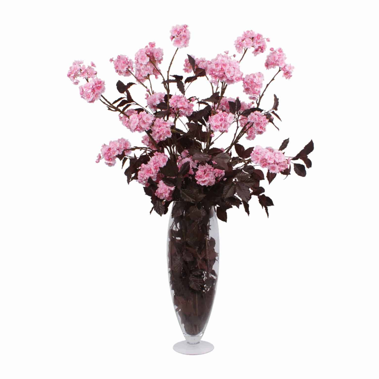 Buy our contemporary cherry blossom artificial flower arrangement. Each flawless stem of many petal pink heads contrasted by rich chocolate beechwood.