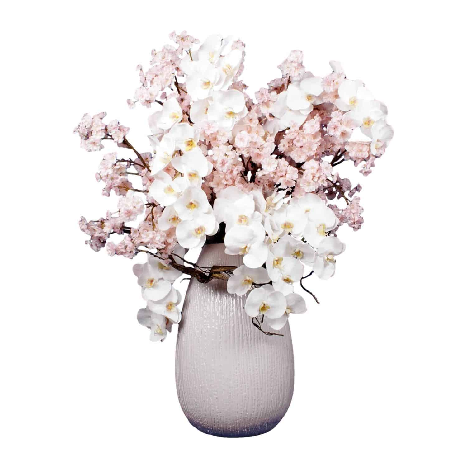 Buy our beautiful blossom and orchid faux arrangement. Clean and elegant