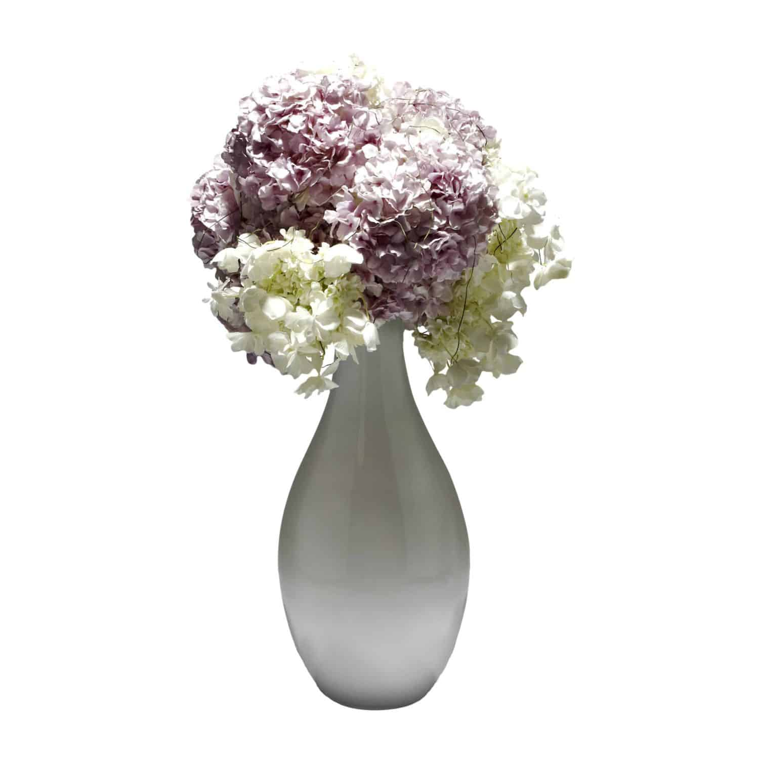Shop for our beautiful pink & white butterfly hydrangea arrangement. Designed in dome and arranged in a white vase for a chic modern look.