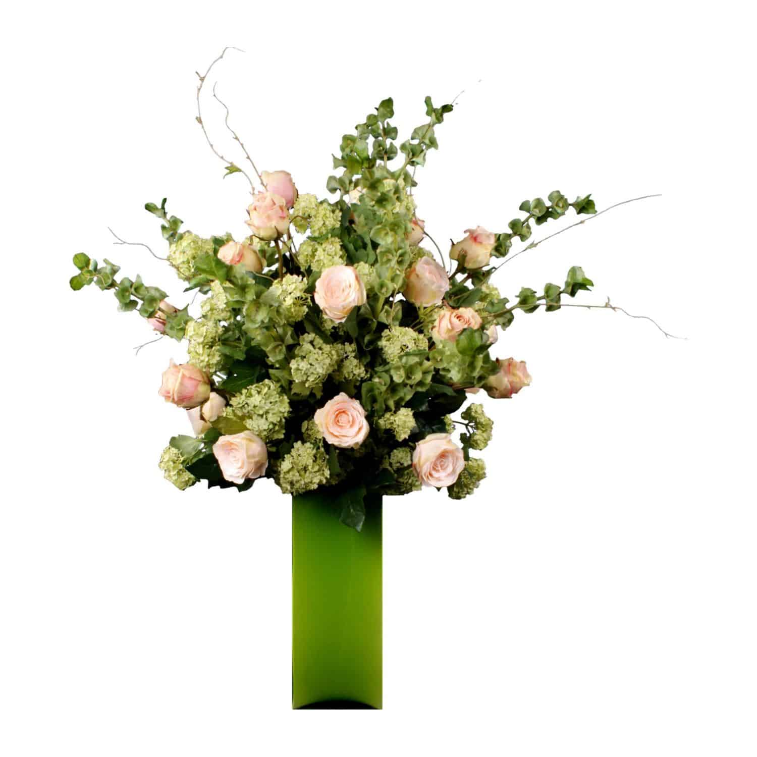 Shop for our pink Austrian and Ecuador silk rose arrangement with Guelder rose and Bells of Ireland. Designed in a contemporary square green glass vase.