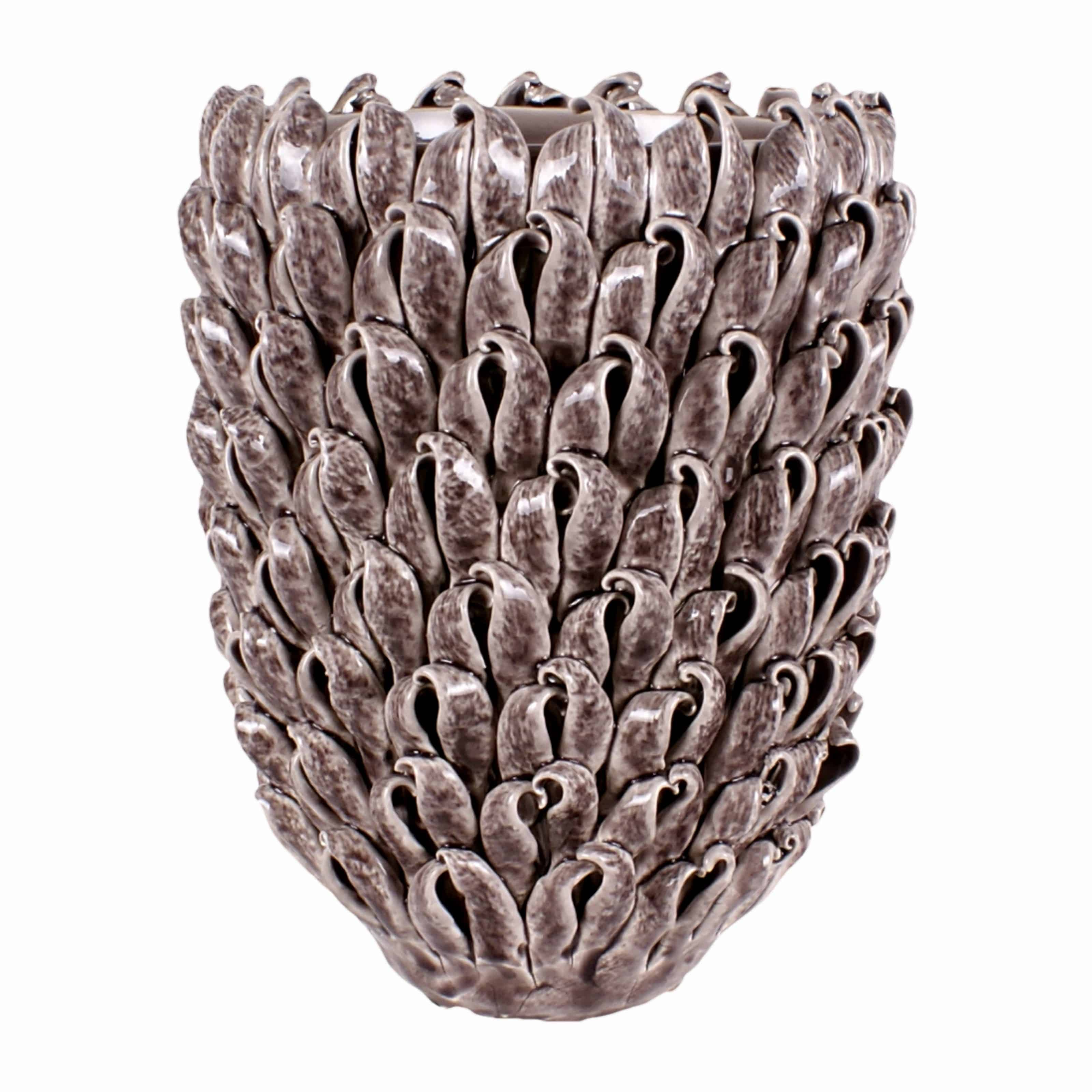 Buy our distinctive hand made seashell effect ceramic flower vase. Strong enough for large flower arrangements and plants. A modern showpiece for any home.