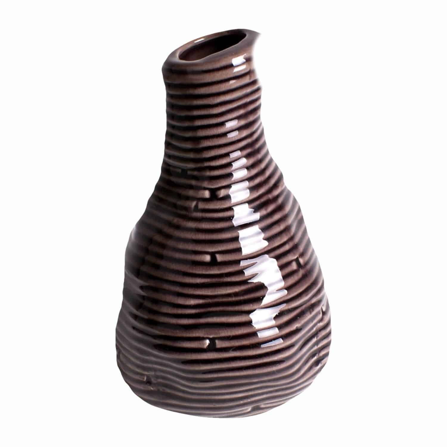 Shop for our handmade glazed vase. A distinctive aubergine colour and natural unevenness