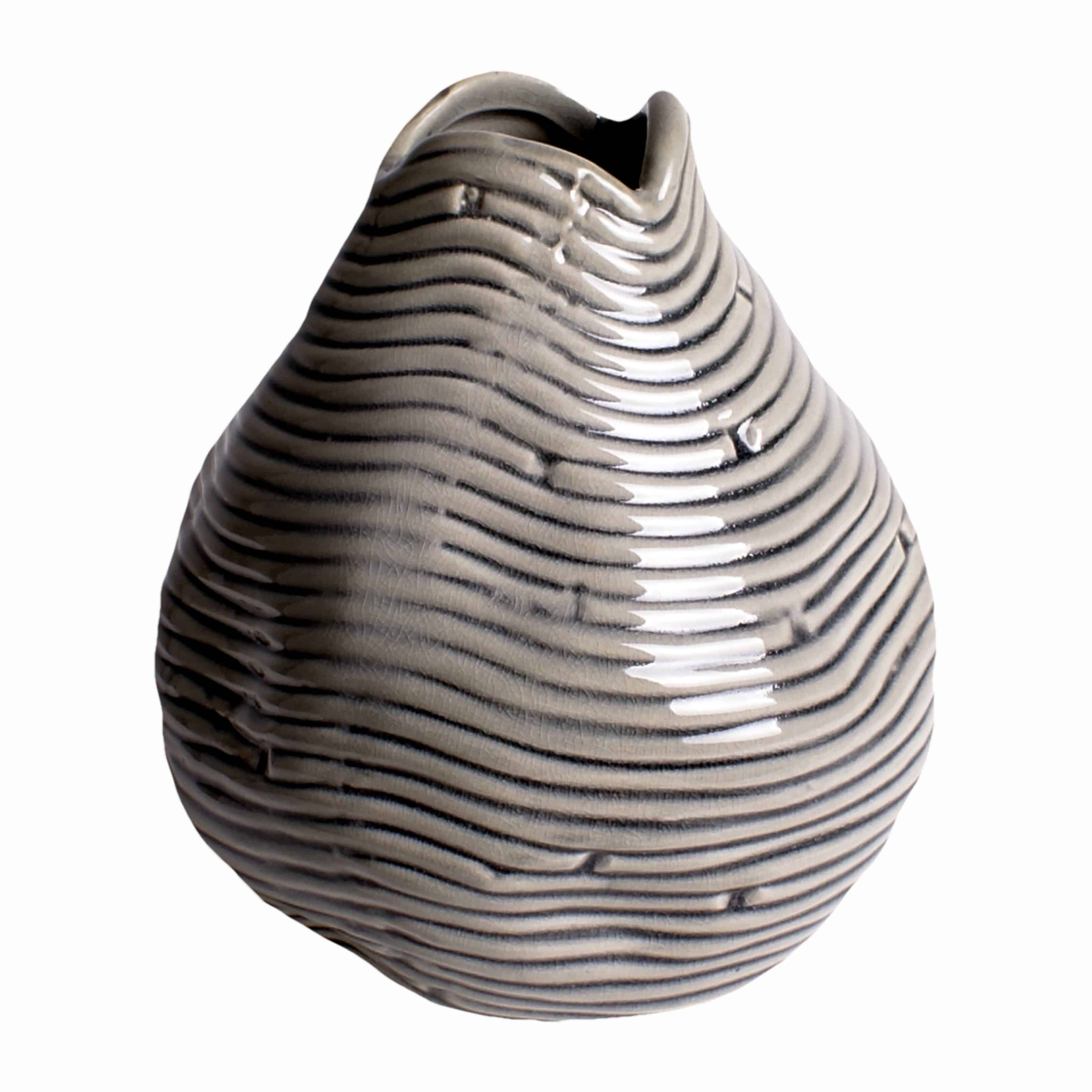 Buy our unique teardrop handmade vase. A decorative grey design creating differing shades Perfect for a few silk flower stems or branches for stylish decor.